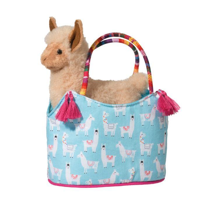 stuffed animal llama in designer tote bag.