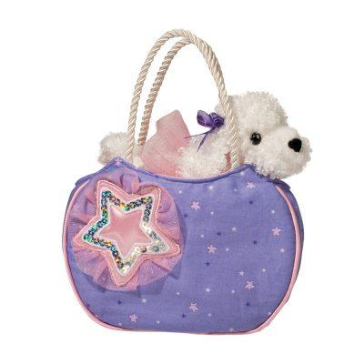 white fluffy stuffed animal poodle in fashion bag.