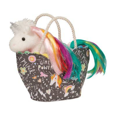 Stuffed animal unicorn in fashion tote bag.