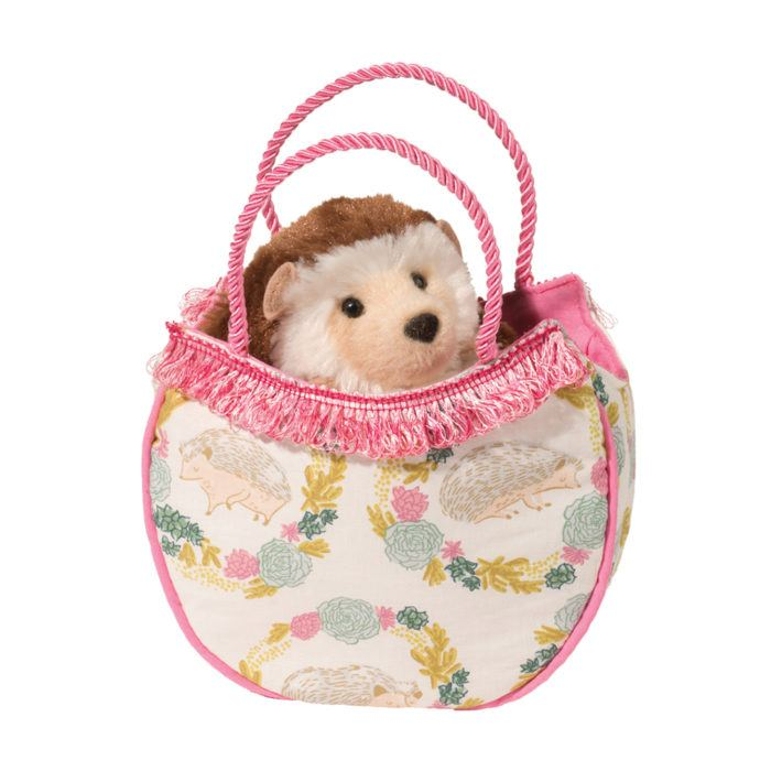 hedgehog stuffed animal in fashion tote bag.