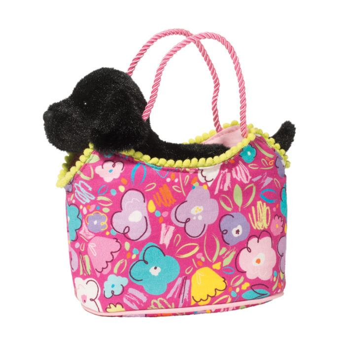 black labrador retriever stuffed animal in animal tote.