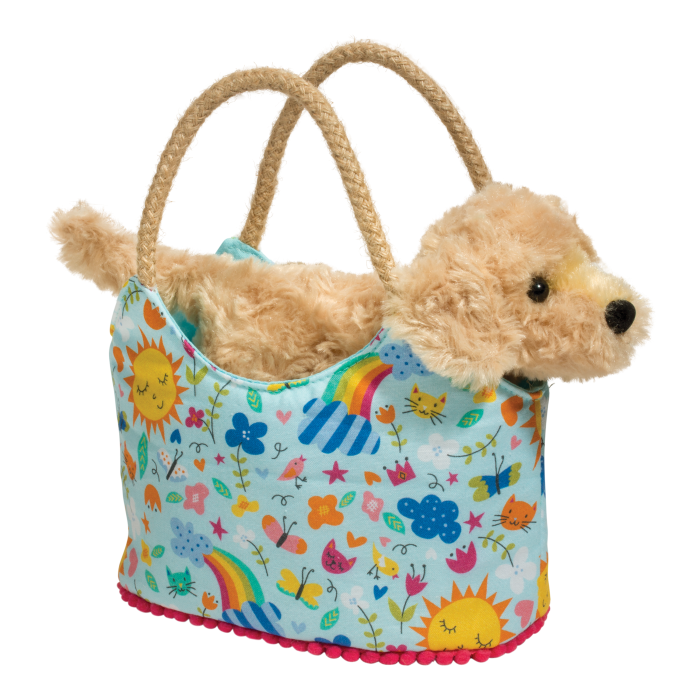 sweet golden retriever dog in designer tote bag for kids
